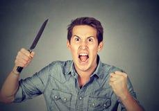 Gniewny agresywny mężczyzna z nożem Obraz Stock