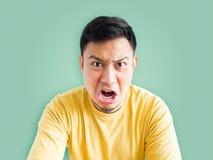 gniewny azjatykci mężczyzna Fotografia Royalty Free