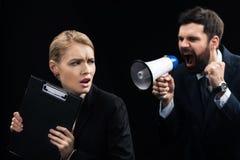 Gniewny biznesmen krzyczy na koledze z głośnikiem Zdjęcie Royalty Free