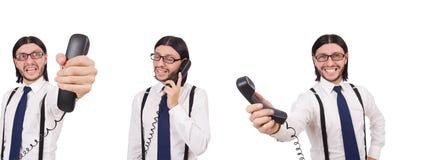 Gniewny biznesmen z telefonem odizolowywającym na bielu obraz stock