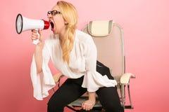 Gniewny bizneswoman z głośnikiem Obraz Royalty Free