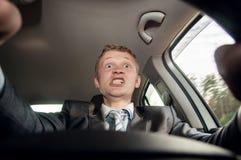 Gniewny kierowca na drogowym jeżdżeniu samochód Zdjęcie Stock