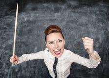 Gniewny krzyczący nauczyciel z pointerem zdjęcie royalty free