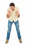 Gniewny mężczyzna krzyczy przy podłoga obraz stock