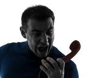 Gniewny mężczyzna na telefon sylwetki portrecie obraz stock