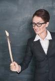 Gniewny nauczyciel z drewnianym kijem zdjęcie royalty free