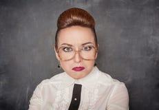 Gniewny nauczyciel z eyeglasses obraz royalty free
