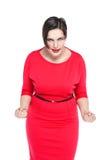 Gniewny piękny plus wielkościowa kobieta w czerwieni sukni odizolowywającej Zdjęcie Royalty Free