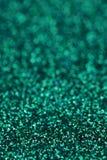 Gnistrandet för turkosgräsplanblått blänker bakgrund Ferie jul, valentin, skönhet och spikar abstrakt textur Royaltyfri Foto
