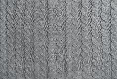 Gnitted wool background Knitting pattern. Grey knitted wool background. Knitting pattern royalty free stock photo