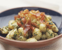 Gnocchi. With bacon and parsley Royalty Free Stock Photos