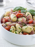 Gnocchi with a Bacon Tomato and Basil Dressing Stock Image