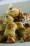 Gnocchi with chanterelle mushrooms Stock Photos