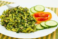Gnocchi con spinaci fotografie stock