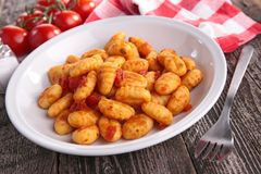 Gnocchi cooked with tomato. Sauce stock photo