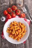 Gnocchi cooked with tomato. Sauce stock images