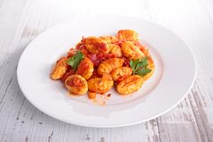 Gnocchi cooked with tomato sauce. And parsley stock photography
