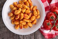 Gnocchi cooked with tomato sauce. On wood royalty free stock photo