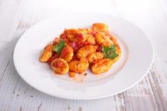 Gnocchi cuit avec la sauce tomate Photographie stock