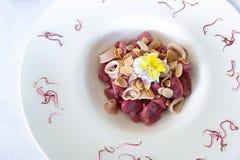 Gnocchi de la frambuesa roja Foto de archivo libre de regalías