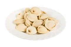 Gnocchi del cinghiale sul piatto, isolati Immagine Stock