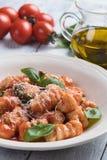 Gnocchi di patata i tomatsås fotografering för bildbyråer