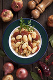 Gnocchi di patata, italian potato noodles. With tomato sauce, olives and sausage Stock Photography