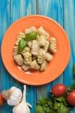 Gnocchi di patata, italian potato noodles. Wih pesto sauce stock photography
