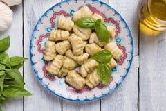Gnocchi di patata, italian potato noodles. Wih pesto sauce royalty free stock photos