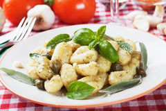 Gnocchi di patata with pesto sauce Stock Photos