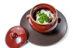 Gnocchi e funghi della carne con panna acida Immagini Stock