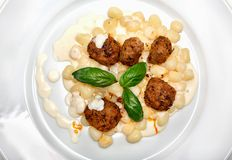 Gnocchi with meat sauce and cheese Royalty Free Stock Image