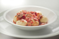 Gnocchi meat souce. Gnocchi with meat souce on white plate stock image