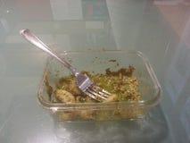 Gnocchi no Pesto na tabela de vidro Imagem de Stock