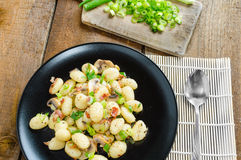 Gnocchi pasta with ham, spring onion Stock Photos