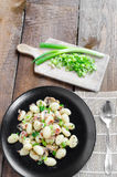 Gnocchi pasta with ham, spring onion Stock Photo
