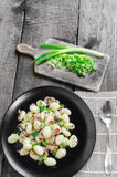 Gnocchi pasta with ham, spring onion Royalty Free Stock Images