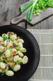 Gnocchi pasta with ham, spring onion Royalty Free Stock Photos