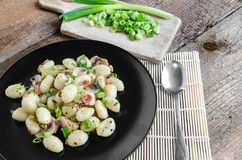 Gnocchi pasta with ham, spring onion Stock Photography