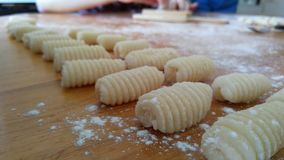Gnocchi pasta on a wooden table Royalty Free Stock Photos