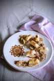 Gnocchi with pears, toasted nuts, honey and cinnamon Stock Photo