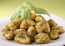 Gnocchi with pesto sauce Stock Photos