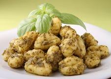 Gnocchi with pesto sauce Stock Photos
