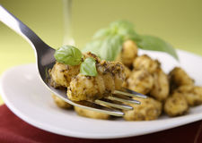 Gnocchi and pesto sauce Stock Photo