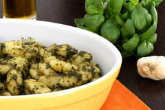 Gnocchi with pesto sauce Stock Images