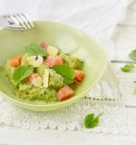 Gnocchi with pesto sauce and smoked salmon Royalty Free Stock Image