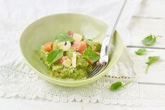Gnocchi with pesto sauce and smoked salmon Stock Images