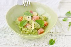 Gnocchi with pesto sauce and smoked salmon Royalty Free Stock Images