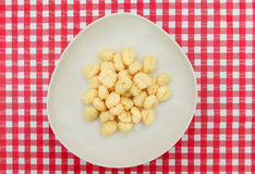 Gnocchi plate on Red and white checkered table Stock Photos