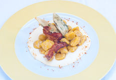 Gnocchi with pumpkin and peanut butter and crispy bacon Royalty Free Stock Photos